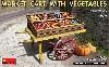 市場のカートと野菜